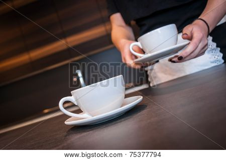 Waitress preparing coffee