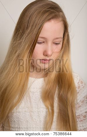 Young Sad Blond Girl Crying