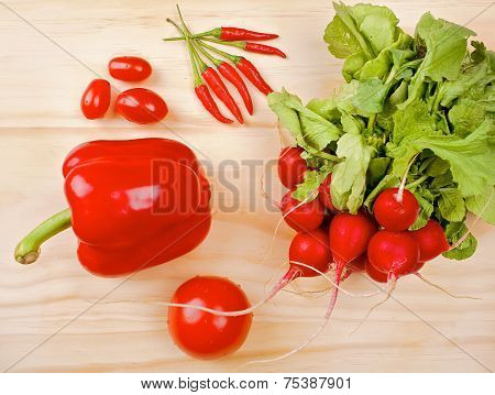 Red vegetables on a wooden background