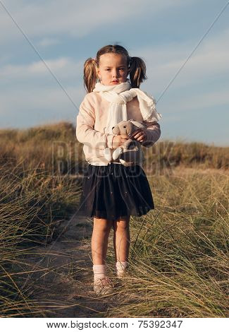 Little Girl With Pigtails Outdoors