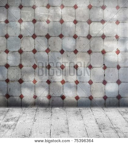 Grunge grey room with mosaic wall tiles and old floorboard