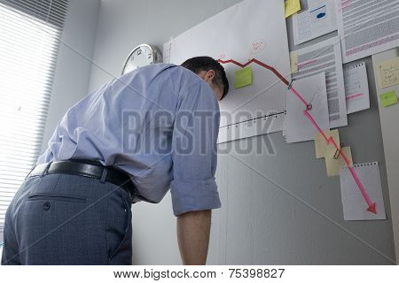 Desperate Businessman Leaning To A Wall