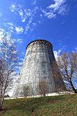 stock photo of chp  - Large factory chimneys on blue sky background  - JPG
