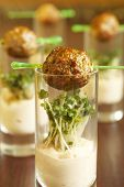 Glasses with meatballs, spicy sauce and mustard sprouts poster