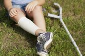 stock photo of lame  - little girl with crutches isolated on white background - JPG