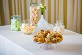 stock photo of cream puff  - Profiterole cream puff - French dessert choux pastry ball filled with whipped cream ** Note: Shallow depth of field - JPG