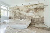 foto of enormous  - Photo of enormous marble bath in spacious bathroom - JPG