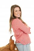 pic of western saddle  - a woman with a smile on her face leaning back on her saddle - JPG