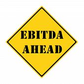 stock photo of amortization  - A yellow and black diamond shaped road sign with the words EBITDA AHEAD making a great concept - JPG