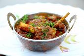 stock photo of nasi  - Indian style meat dish in a copper bowl - JPG