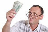 picture of holding money  - senior with money - JPG