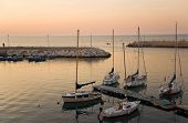 Touristic port of Giovinazzo at sunset. poster