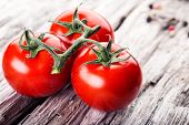picture of roughage  - Fresh cherry tomatoes on the wooden background. ** Note: Shallow depth of field - JPG