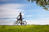 Man On A Bike In A Field