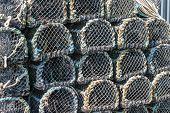 image of lobster boat  - Lobster pots stacked on the quay in Padstow Cornwall England UK - JPG