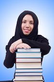 stock photo of niqab  - Young muslim female student with books - JPG