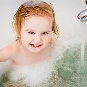 picture of 15 year old  - cute two year old baby bathes in a bath with foam closeup - JPG