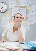 image of stiff  - Tired female white collar with stiff neck working at desk - JPG