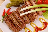 stock photo of scallion  - Grilled sausages with red hot chilli peppers - JPG