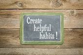 stock photo of slating  - create helpful habits reminder or advice on a  slate blackboard against rustic weathered wood planks - JPG