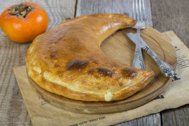 foto of crescent-shaped  - Cheese pie in the shape of a crescent - JPG