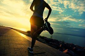 stock photo of jogger  - Runner athlete running at seaside - JPG