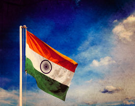 stock photo of indian flag  - Vintage retro effect filtered hipster style image of  India indian flag in blue sky with copyspace with grunge texture overlaid - JPG