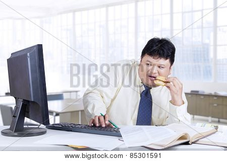 Worried Worker Looking At Monitor