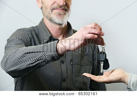 Senior man giving car key