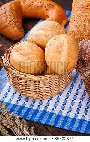 Wicker basket with buns on the tablecloth