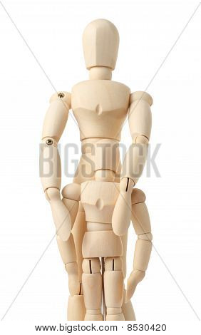 Wooden Figures Of Parent Embracing His Child From Back, Half Body, Isolated On White