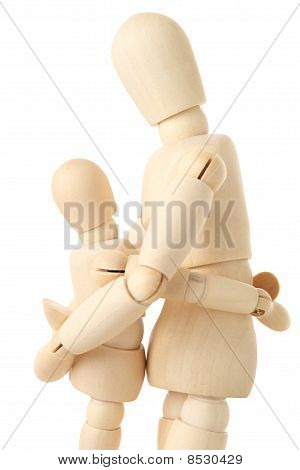 Wooden Figures Of Parent Embracing His Child, Half Body, Side View, Isolated On White