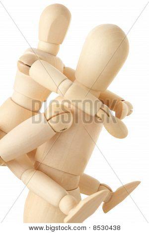 Wooden Figures Of Child Sitting On Back Of His Parent, Half Body, Side View, Isolated On White