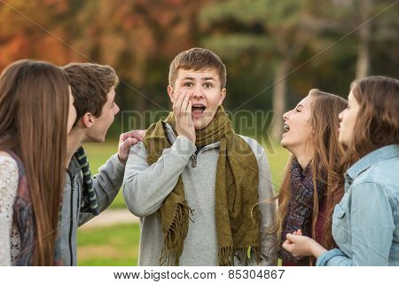 Surprised Male Teen With Friends