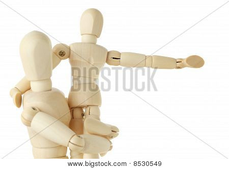 Wooden Figures Of Child Sitting On Hands Of His Parent And Pointing For Hand At Right, Half Body