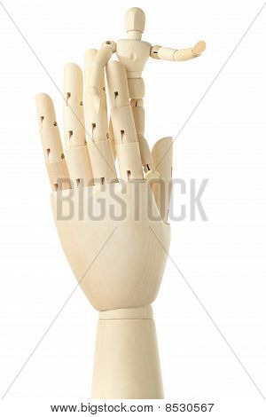 Wooden Figure Of Little Man Standing On Big Hand And Pointing At Right, Isolated On White