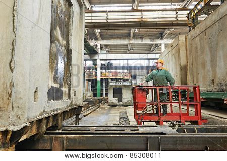 industrial worker at house-building plant factory workshop