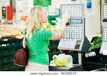 Shopping. Woman weighting banana fruits bio food in vegetable store or supermarket