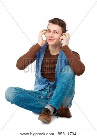 Portrait Of Young Man With Headphones Sitting On The Floor