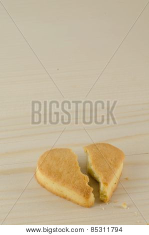 Broken heart cookies on wooden background love concept
