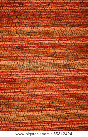 Reddish color fabric pattern as a background
