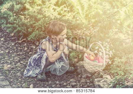 Girl Collects Colorful Easter Eggs In A Basket - Retro