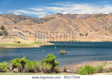 Mountain lake and sailboats