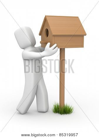 Man sets birdhouse