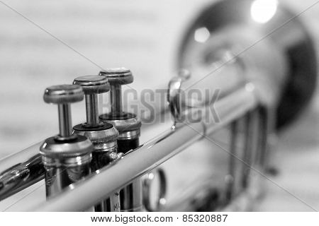 Black and White Trumpet with out of focus sheet music