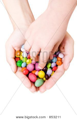 Hands with sweets