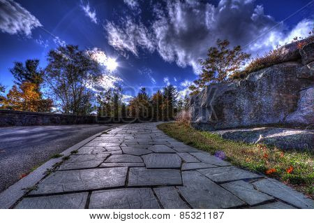 Shiny Stone Sidewalk with Time Lapse Sky