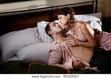 Beautiful couple is making love in the bed