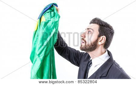 Businessman holding a Brazilian flag on white background