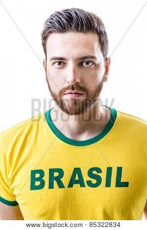 Man on yellow Brasil t-shirt on white background